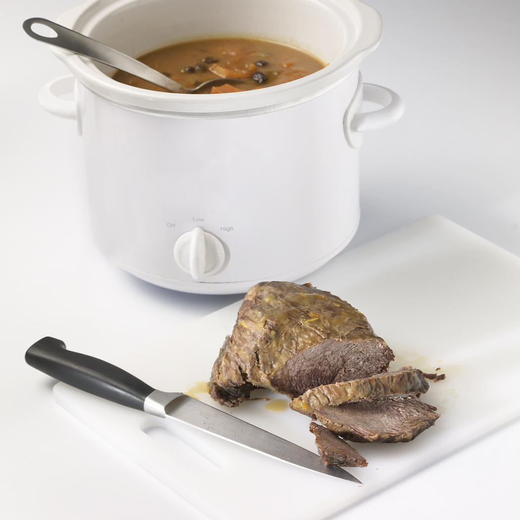 Remove roast from slow cooker; place on cutting board. Cover to keep warm. In small bowl, whisk together cold water and flour; mix into vegetables and juices in slow cooker. Mix in orange peel; cover. Cook on HIGH setting 15 minutes or until thickened. Slice roast.