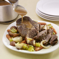 Cut roast into serving-size pieces; serve with vegetables and gravy.