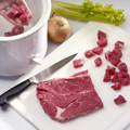 Cut steak into 3/4-inch cubes; place in 3- to 4-quart slow cooker.