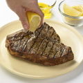 Drizzle steak with olive oil and lemon juice.