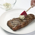 Top steak with butter mixture.
