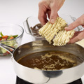 In 12-inch skillet, heat oil over medium-high heat. Add steak; cook, stirring frequently, 7 to 8 minutes or until browned. Remove steak and juices from skillet. Pour water into skillet; bring to a boil. Stir in seasoning packet from soup mix and stir-fry sauce. Break noodles from soup mix into liquid; return to a boil, stirring frequently. Boil, breaking up noodles, 2 minutes.