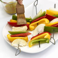 Prepare grill for direct medium heat; position rack 5 to 6 inches from heat source. Alternately thread bell peppers and onion onto 4 (12-inch) metal skewers. Brush with 1/4 cup vinaigrette.