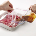 In recloseable plastic food storage bag, combine steaks and marinade; seal. Refrigerate, turning bag occasionally, 2 to 4 hours.