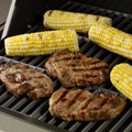 Prepare grill for direct medium-high heat; position rack 5 to 6 inches from heat source.  Lightly oil grill rack. Remove steaks from marinade; discard marinade. Place steaks on grill; cover. Grill, turning once, 10 to 12 minutes or until fully cooked (165°F.). Let stand 5 minutes.