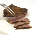 Prepare grill for direct medium-high heat; position rack 5 to 6 inches from heat source. Lightly oil grill rack. Place steak on grill; cover. Grill, turning once, 6 to 8 minutes or until fully cooked (165°F.). Let stand 5 minutes. Thinly slice across grain.