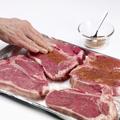 Rub all surfaces of steaks with jerk seasoning.