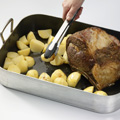 Move roast to one side of pan; add potatoes to pan, turning to coat in drippings. Bake, stirring potatoes halfway through, 30 to 45 minutes or until fully cooked (165°F.).