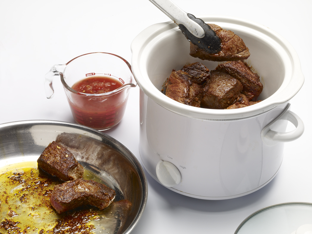 Heat a small amount of oil in a large saucepan.  Add roast and sear pieces on all sides.  Place roast in slow cooker and add salsa casera. Cover and cook on LOW for 6 to 8 hours or on HIGH for 4-5 hours until roast is fork tender.