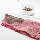 Heat grill to MEDIUM-HIGH. Combine oil, sugar, garlic salt, oregano and cumin in small bowl. Rub evenly onto steaks.