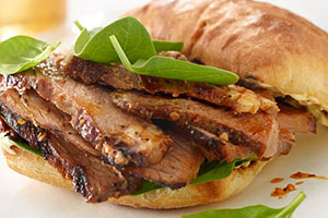 Place thinly sliced grilled steak on bottom portion of each dinner roll, top with baby spinach and upper portion of dinner rolls.
