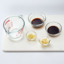 Combine water, soy sauce, vinegar, garlic and ginger in small bowl; set aside.