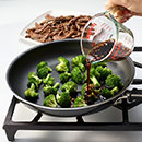 Using the same skillet, add broccoli and sauce mixture.  Bring to a boil.  Cook 5 to 7 minutes until broccoli is heated through.