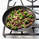 Add cooked beef to skillet; stir to combine.