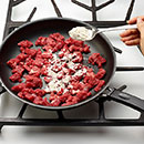 Heat oven to 350°F.  Heat oil in 12-inch nonstick skillet on MEDIUM-HIGH.  Add stew meat and flour.  Cook 5 to 7 minutes until cooked through, stirring frequently.
