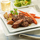 Cut roast into serving-size pieces; serve with roasted red potatoes and carrots.