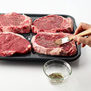 Heat broiler.  Arrange on broiling pan.  Brush both sides of steaks with oil and season with salt and pepper.  Adjust oven rack so tops of steaks are 4 to 6 inches from heat. Broil 10 minutes; turn steaks over.  Broil 6 to 8 minutes longer until fully cooked.