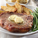 To serve, place steaks on plates and top with rounds of bourbon butter.  Allow to rest 5 minutes before serving.