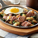 To serve, place potato hash in the center of each of 4 plates.  Top with steak and a fried egg.